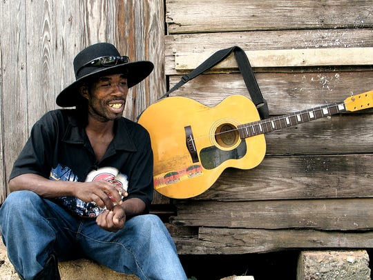 Guitar player Jamaica Brushy One-String is among the