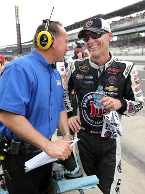 NASCAR driver Kevin Harvick is all smiles as he jokes with Dr. Jerry Punch with ESPN moments after climbing out of his car after winning the pole at the Indianapolis Motor Speedway on Saturday, July 26, 2014. Harvick broke the track qualifying record with a speed of 188.470.