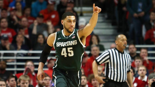 Michigan State guard Denzel Valentine  reacts after a made basket against the Wisconsin Badgers during the first half in the championship game of the Big Ten Tournament at United Center on March 15, 2015.
