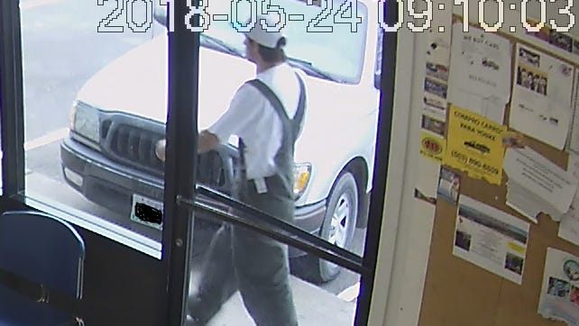 Woodburn police are searching for a man suspected of robbing a restaurant at gunpoint.