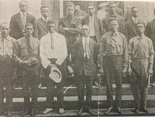 Recruits are photographed on the courthouse steps in