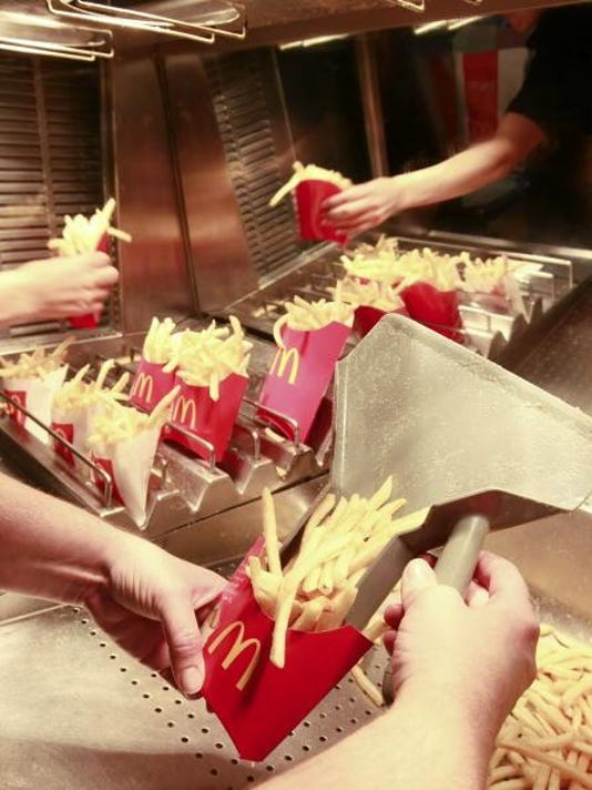 An employee packages french fries at a McDonald's Corp. rest