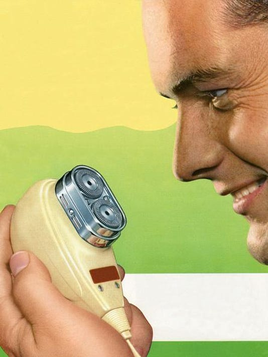 1950s Man Using Electric Razor