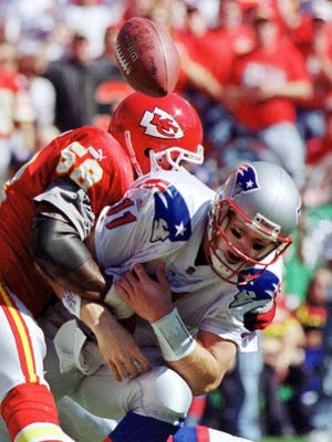New England Patriots quarterback Drew Bledsoe loses the ball during a sack by Kansas City Chiefs linebacker Derrick Thomas during the first quarter of their 10 October 1999 game at Kansas City's Arrowhead Stadium.