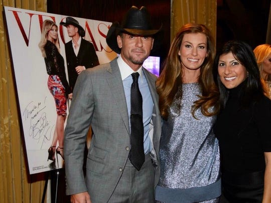 Rush-Henrietta graduate Dayna Roselli, far right, with music superstars Tim McGraw and his wife, Faith Hill. Roselli is a news anchor and reporter for the ABC affiliate in Las Vegas and has also been an entertainment reporter.