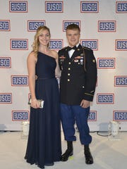 Spc. Christian Sheers stands with his wife, Jessica Sheers, at the USO gala Tuesday in Washington, D.C.