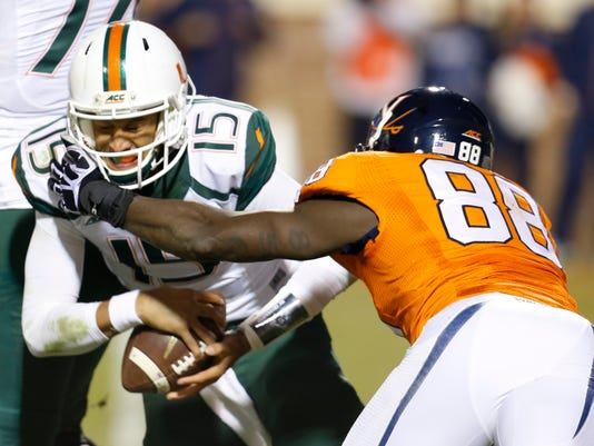 Miami quarterback Brad Kaaya (15) is sacked by Virginia linebacker Max Valles (88) during the second half of an NCAA college football game in Charlottesville, Va., Saturday, Nov. 22, 2014. Virginia won the game 30-13. (AP Photo/Steve Helber)