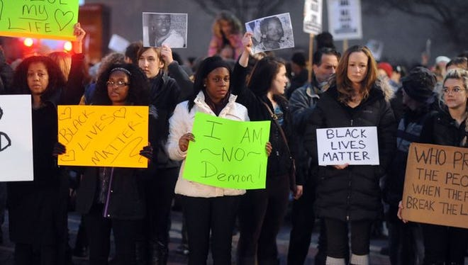 Protesters rally in Asheville in response to the Ferguson verdict on Nov. 25.