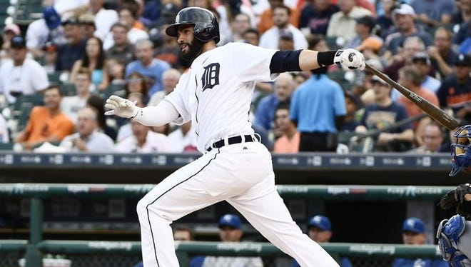 Tigers outfielder J.D. Martinez hits a double in the second inning against the Royals on Tuesday at Comerica Park.