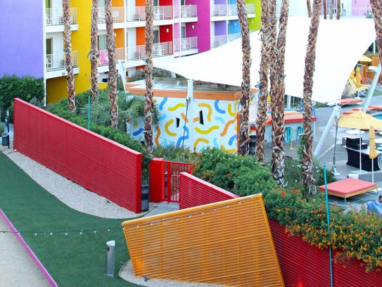 A mural of pool noodles can be seen painted on the