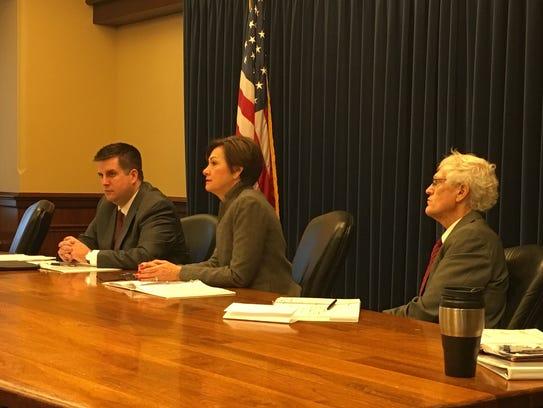 Gov. Kim Reynolds listens to a budget presentation