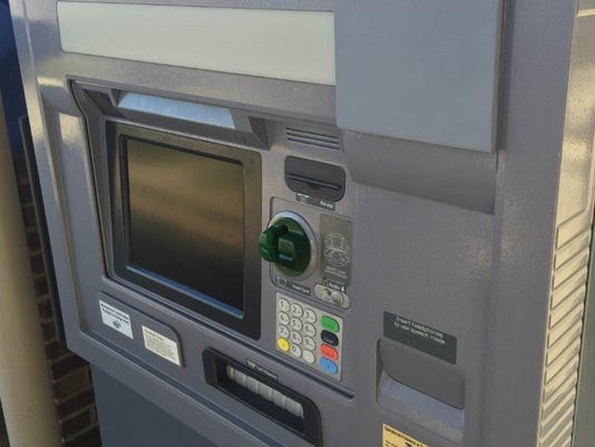ATM with skimmer attached