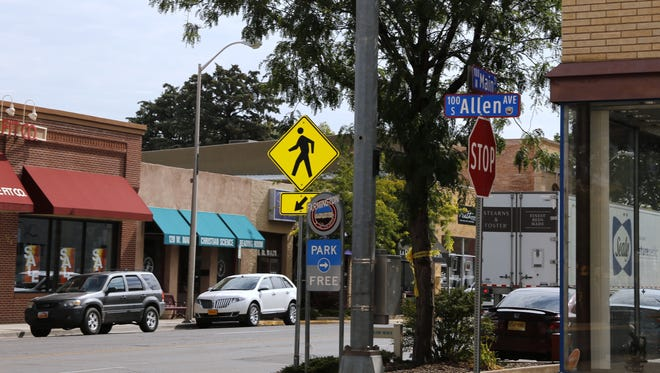 Some downtown Farmington merchants have mounted a campaign to encourage people to express their concerns about the removal of traffic signals from intersections in the district, including the one at Allen Avenue and Main Street.
