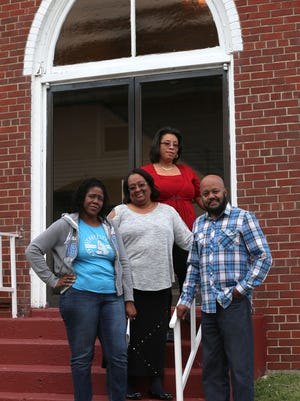 """Tiger Bradley stands with the actresses in the play that he wrote """"the Hurt and the Healed"""" which will be performed at New Community Temple Church on May 13 at 6 p.m. With Bradley are (from left to right) Yronne Mack, LaConia James-Ross, and Monica Johnson."""