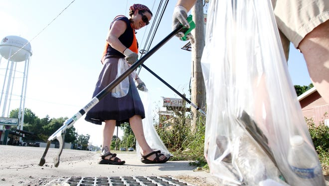 The 705 group join other volunteers to clean up trash along Bertrand Drive in Lafayette.
