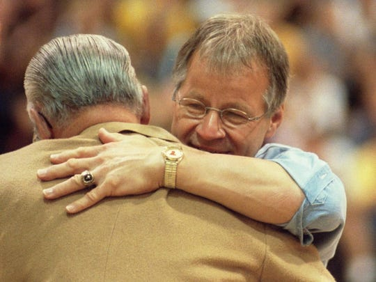 Former Technical High School Principal Ed Johnson hugged former school principal Chuck Sell during the hour-long tribute in 1999.