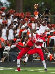 Lely High School's Jean Joseph goes up for the ball during a game against Immokalee High School in Immokalee, Fla., on Friday, Sept. 1, 2017.