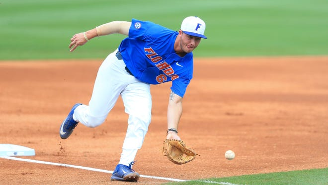 Florida infielder Jonathan India (6) fields a ground ball the first inning of an NCAA college super regional baseball game against Wake Forest on Monday, June 12, 2017, in Gainesville, Fla.
