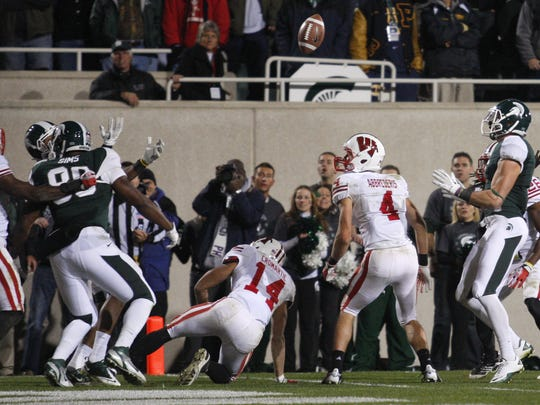 The ball goes up for grabs as MSU's Keith Nichol, right, waits for it to score the winning TD against Wisconsin on Oct. 22, 2011.