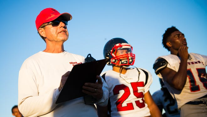 Centennial coach Richard Taylor watches plays during football practice in Peoria on Monday, Aug. 3, 2015.