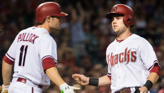 Arizona Diamondbacks center fielder A.J. Pollock (11) congratulates second baseman Chris Owings (16) on his run in the 2nd inning to bring the Diamondbacks ahead of the Phillies 4-1 at Chase Field on Tuesday, August 11, 2015, in Phoenix, AZ.