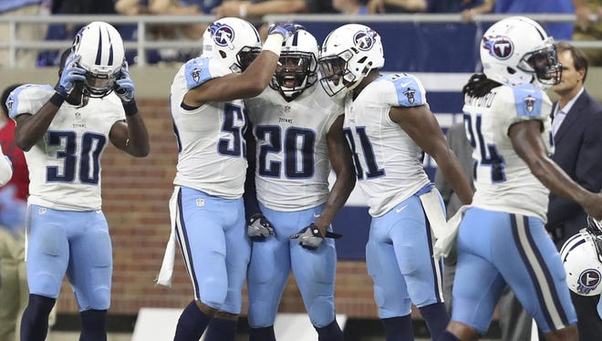 Titans cornerback Perrish Cox (20) celebrates with inside linebacker Wesley Woodyard (59) and safety Kevin Byard (31) after an interception during the fourth quarter against the Lions on Sept. 18, 2016..