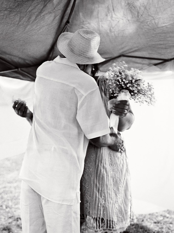 Levon Brooks kisses his bride, Dinah, at their 2016