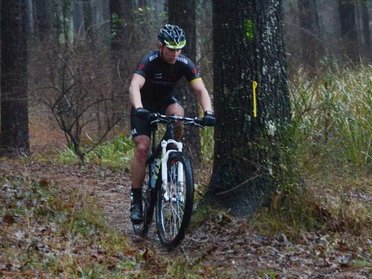 John Fell of Scott nears the finish line of the Wild Azalea Trail Challenge on Saturday 5 in the Kisatchie National Forest. Fell completed a 27-mile bike ride. The challenge included a 50-mile bike ride, a 50-mile trail run, a 27-mile bike ride and a 27-mile run.