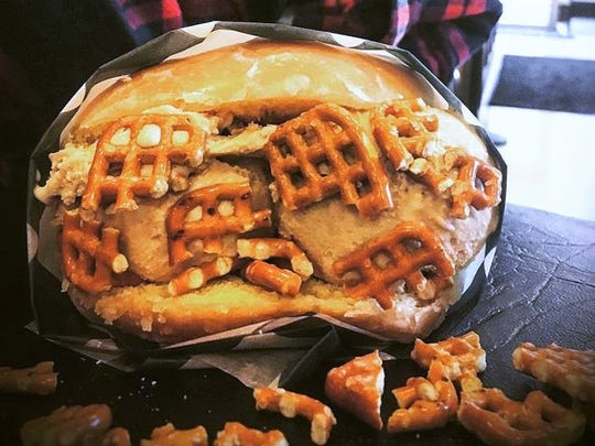 A spilt, glazed doughnut is stuffed with bourbon espresso ice cream and coated in salted waffle pretzels at The Yummi Bunni, a Fort Wayne ice cream parlor coming to Indianapolis' Fountain Square neighborhood in summer 2018.