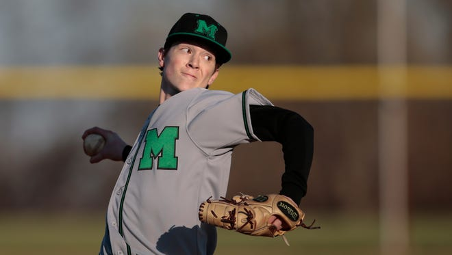 Mason pitcher Will Pfennig (3) delivers to the plate during the high school baseball game between the Mason Comets and Colerain Cardinals, Tuesday, March 29, 2016, at Colerain High School. Mason won 9-4.