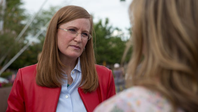Christine Jones speaks to a supporter at a meet-and-greet on April 29, 2016, in Gilbert. Jones, a Republican, is entering the race to replace the retiring U.S. Rep. Matt Salmon, R-Ariz., in the East Valley's 5th Congressional District.