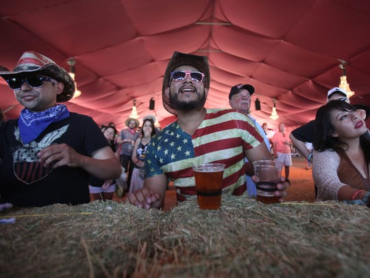 Fans watch Robert Ellis perform during the Stagecoach Country Music Festival in 2017.
