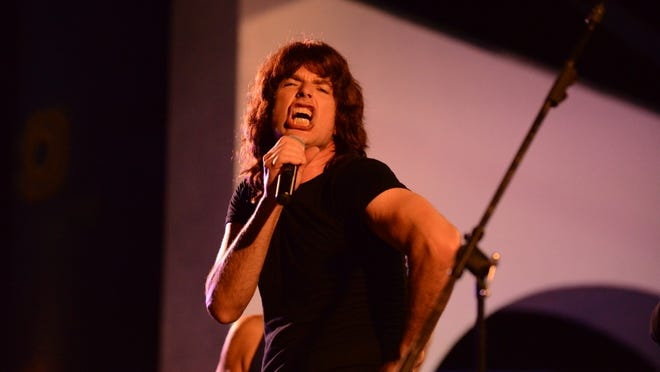 Doug Baird portrays Mick Jagger in The Rolling Stones tribute band The U.S. Stones.