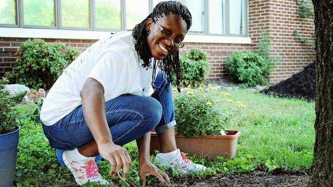 A Hands On Nashville Day volunteer helps with landscaping one of Nashville's public schools.