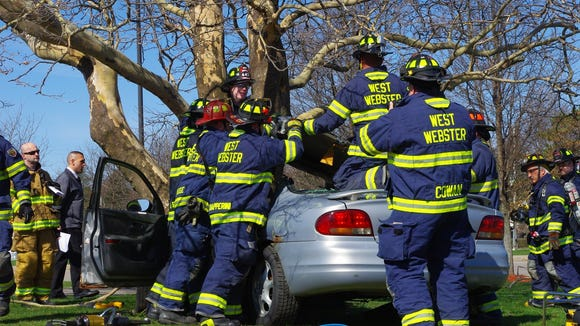 West Webster firefighters remove the roof of the crashed car so they extract the deceased passenger. To see more photos from the event, go to https://www.facebook.com/media/set/?set=a.651777854889040.1073741850.106010792799085&type=3.