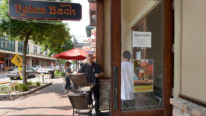 Signs posted on the Palafox Place doorways to Helen Back Again alert customers of the restaurant's closure on Tuesday, May 27. Owner Chris Sehman says he plans to announce the restaurant's new location soon.