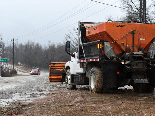 An Arkansas State Highway and Transportation Department snow plow is staged near the Baxter/Fulton county line Wednesday morning before Winter Storm Thor hit the Twin Lakes Area. AHTD has spent $1 million on materials alone to help treat roads in north central and northwest Arkansas this winter.