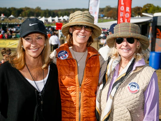 From left, Kristin Alexandre of Far Hills, Tina Jemison of Nantucket, RI, and Heidi Lyons of Upperville, VA at the 96th running of the Far Hills Race Meeting on October 15, 2016.