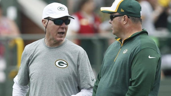 Packers general manager Ted Thompson (left) is responsible for the makeup of the team. Head coach Mike McCarthy's sphere of responsibility is the team on the field.