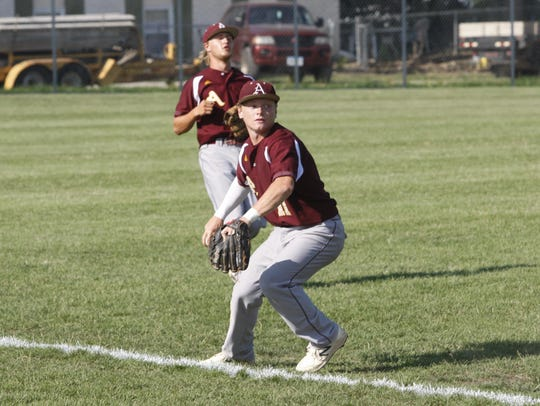 Ankeny shortstop Drew Hill looks to make a throw to