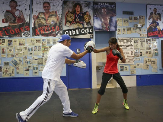 Gabriela Fundora trains with her father/trainer Freddy Fundora at the Coachella Valley Boxing Club.