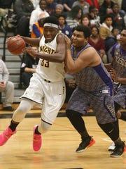 McQuaid's Isaiah Stewart drives to the basket against East's Tyrique Hasan (42).