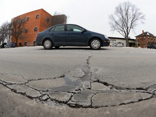 Cracked pavement and an uneven surface test cars on