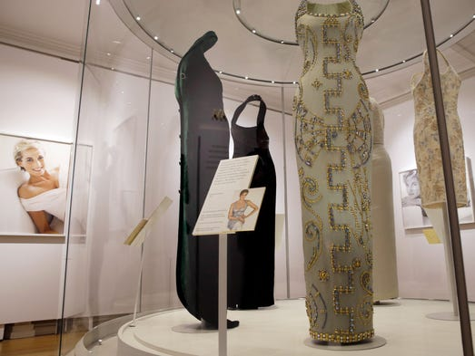 A Versace ice blue silk gown with beading, centre,