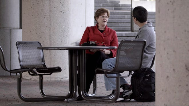 Kathleen Cleary, associate provost for student completion at Sinclair Community College in Dayton, talks with students.