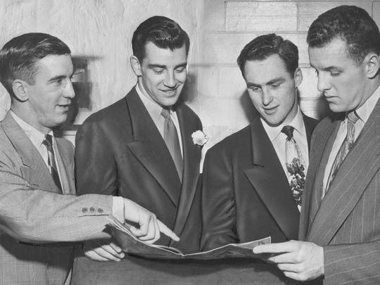 Red Wings players Ted Lindsay, from left, Michael Kirby, Red Kelly and Ed Sandford read a magazine in 1951.