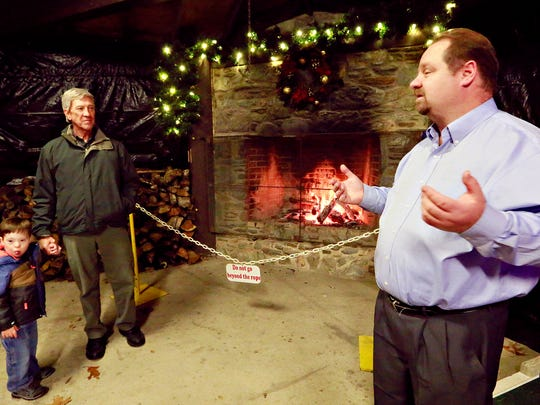 Scott Palcher, right, with American Design and Build, talks about Christmas Magic at Rocky Ridge County Park in Springettsbury Township, Friday, Nov. 24, 2017. American Design and Build is an event sponsor and is located in Hartford County, Maryland. Dawn J. Sagert photo