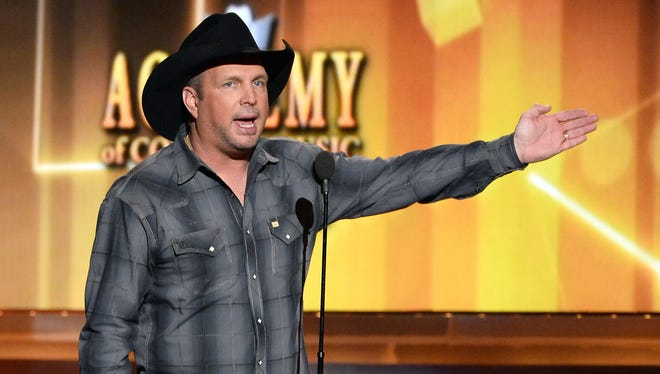 Garth Brooks speaks during the Academy of Country Music Awards on April 6 in Las Vegas.