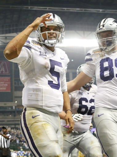 Kansas State quarterback Alex Delton (5) celebrates with tight end Blaise Gammon (89) after scoring a touchdown against UCLA during the fourth quarter of the Cactus Bowl at Chase Field in Phoenix, Ariz. December 26, 2017.
