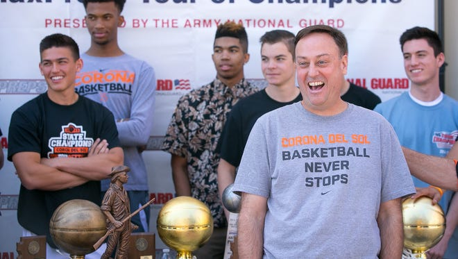 Tempe Corona del Sol head coach Sam Duane Jr. after accepting the Army National Guard National Rankings Trophy at their school in Tempe on Wednesday, April 8, 2015.